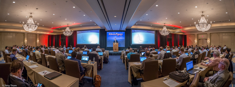 Panoramic photo of training conference showing room size