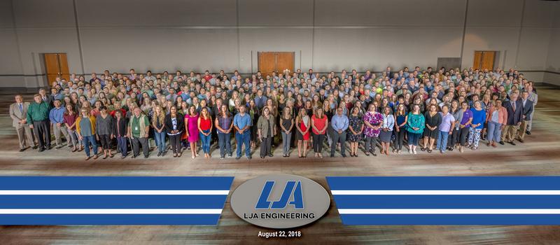 Large Panoramic group company photo of LJA Engineering employees
