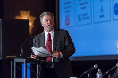 Keynote speaker at podium in Houston, Texas